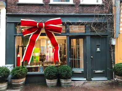 A brightly decorated shopfront wrapped as a present