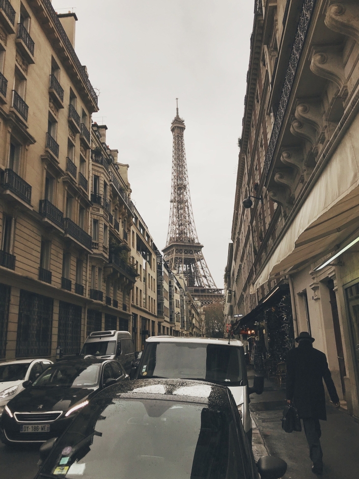 The Eiffel Tower seen through a quiet Parisienne street